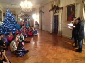 The director Cathy Jones (right) arranges the children for The Spirit of Christmas music video shoot.